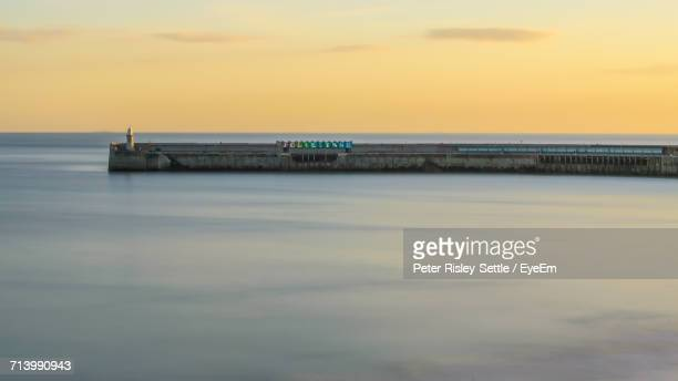 scenic view of sea against sky during sunset - folkestone stock pictures, royalty-free photos & images