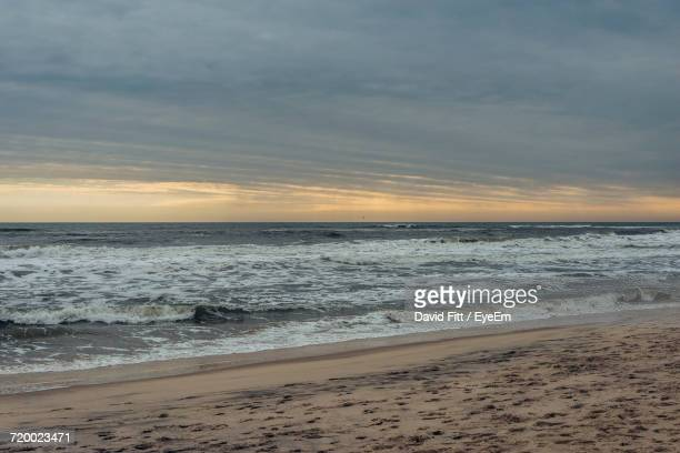 scenic view of sea against sky during sunset - sag harbor stock photos and pictures