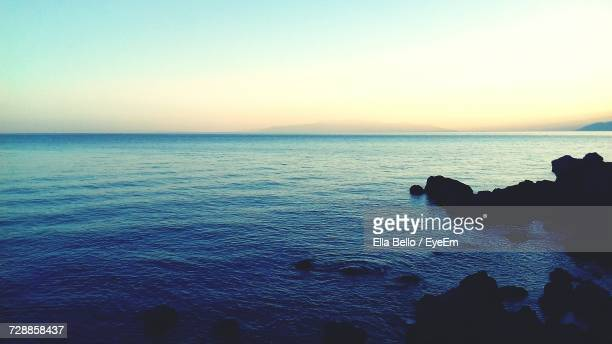 scenic view of sea against sky during sunset - ella bello stock-fotos und bilder