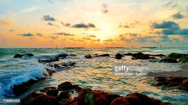 scenic view of sea against sky during sunset - marco island stock pictures, royalty-free photos & images
