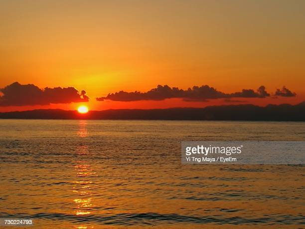 scenic view of sea against sky during sunset - zushi kanagawa stock photos and pictures