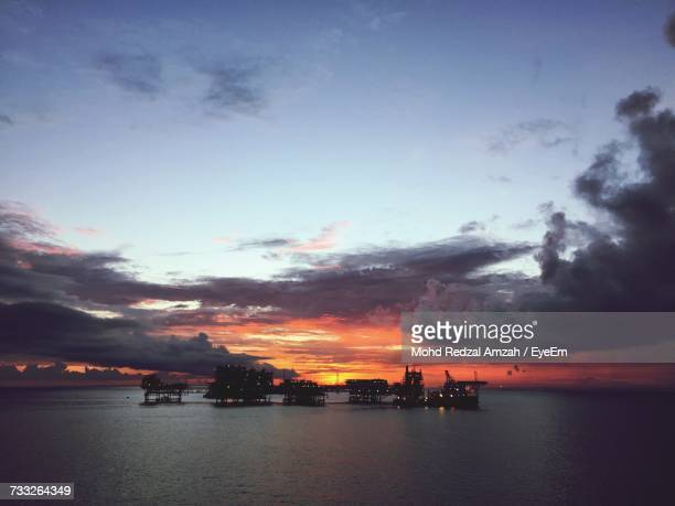 scenic view of sea against sky during sunset - brunei stock pictures, royalty-free photos & images