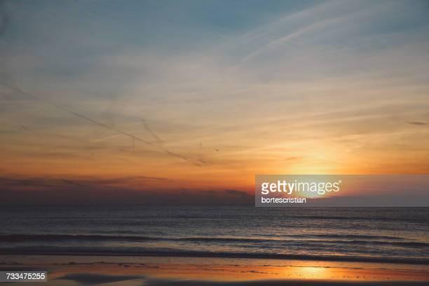 scenic view of sea against sky during sunset - bortes cristian stock-fotos und bilder