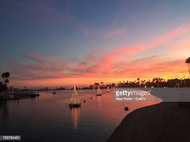scenic view of sea against sky during sunset - seal beach stock pictures, royalty-free photos & images