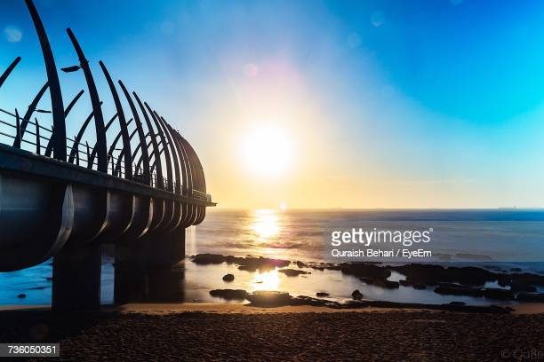 scenic view of sea against sky during sunset - durban beach stock photos and pictures