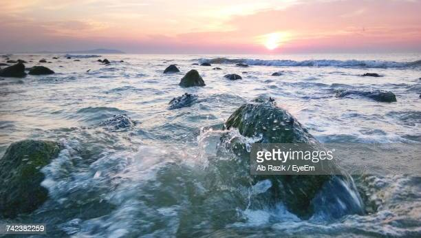 scenic view of sea against sky during sunset - kuantan stock pictures, royalty-free photos & images