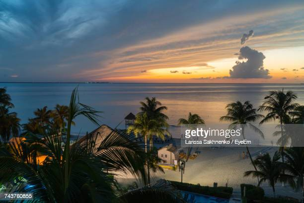 scenic view of sea against sky during sunset - isla mujeres ストックフォトと画像