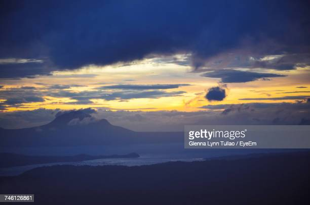 scenic view of sea against sky during sunset - taal volcano stock photos and pictures