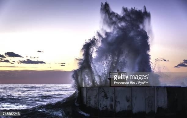 scenic view of sea against sky during sunset - retaining wall stock pictures, royalty-free photos & images