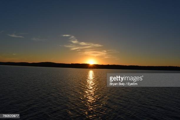 scenic view of sea against sky during sunset - branson missouri stock pictures, royalty-free photos & images