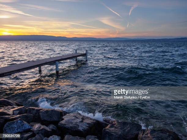 scenic view of sea against sky during sunset - marek stefunko stockfoto's en -beelden