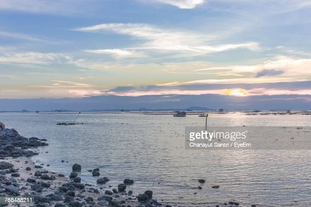 scenic view of sea against sky during sunset - chanayut stock photos and pictures