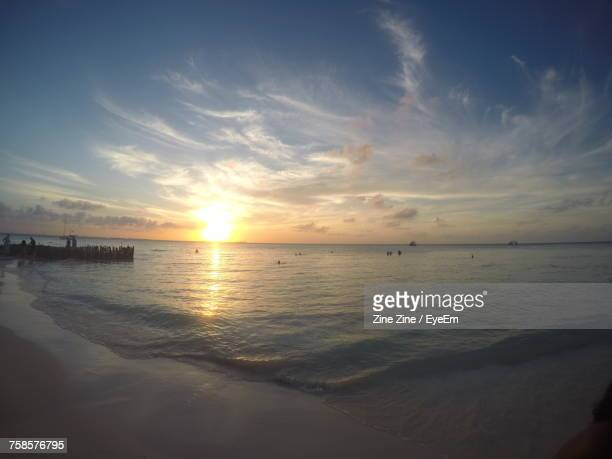 scenic view of sea against sky during sunset - isla mujeres stock photos and pictures