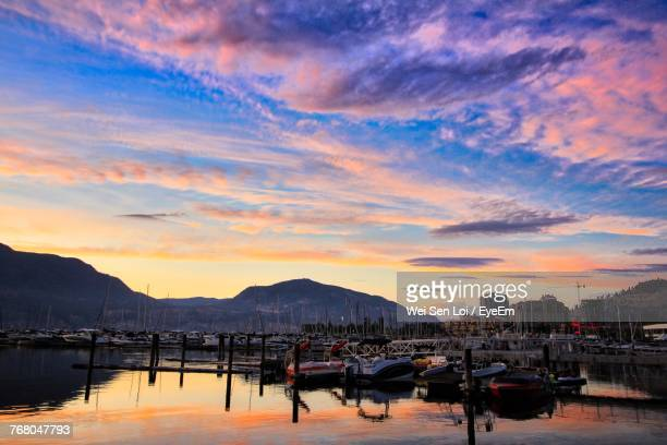 scenic view of sea against sky during sunset - kelowna stock pictures, royalty-free photos & images