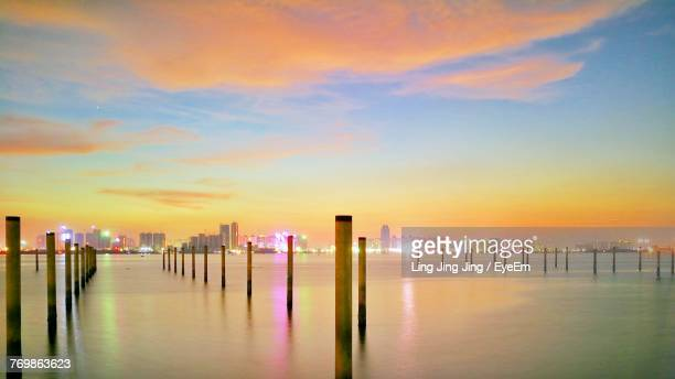 scenic view of sea against sky during sunset - zhongshan stock-fotos und bilder