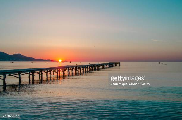 scenic view of sea against sky during sunset - muro stock photos and pictures