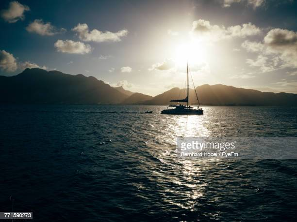 scenic view of sea against sky during sunset - catamaran stock photos and pictures