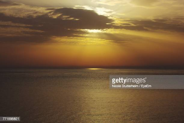 scenic view of sea against sky during sunset - stutterheim stock photos and pictures