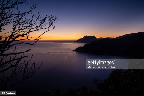 scenic view of sea against sky during sunset - michael jaeger stock pictures, royalty-free photos & images