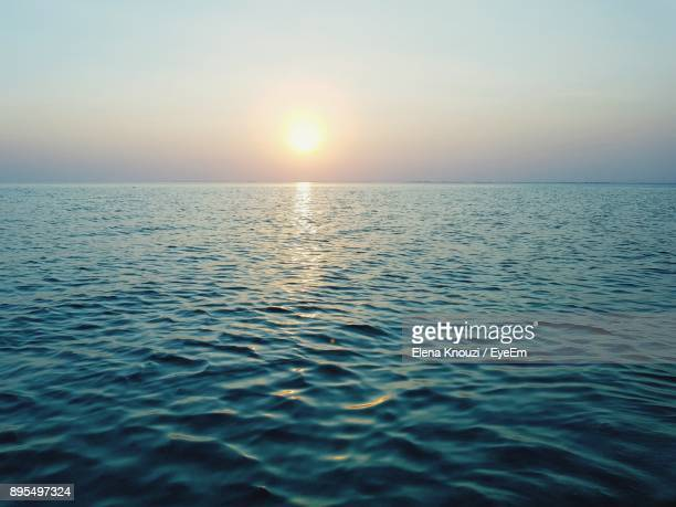 scenic view of sea against sky during sunset - elena knouzi stock pictures, royalty-free photos & images