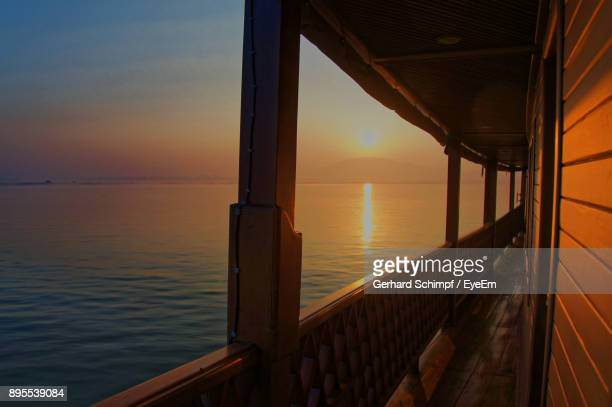 scenic view of sea against sky during sunset - gerhard schimpf stock photos and pictures