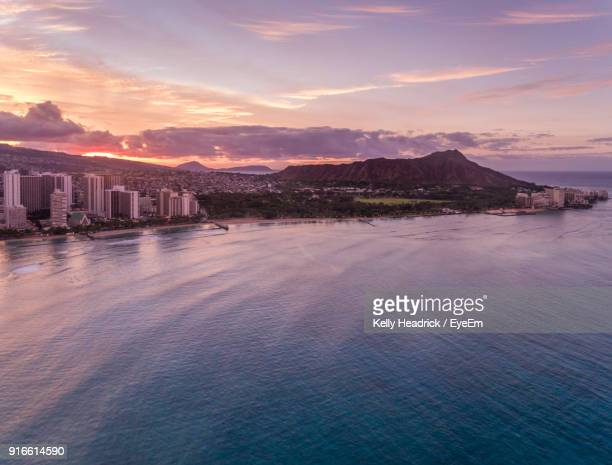 scenic view of sea against sky during sunset - diamond head stock photos and pictures