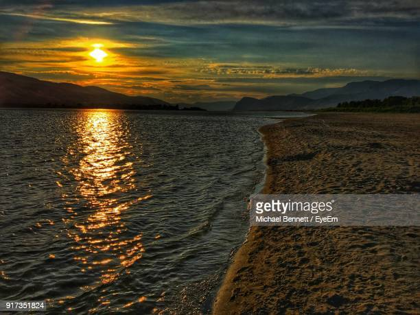scenic view of sea against sky during sunset - kamloops stock pictures, royalty-free photos & images