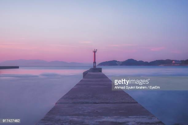 scenic view of sea against sky during sunset - matsuyama ehime stock pictures, royalty-free photos & images