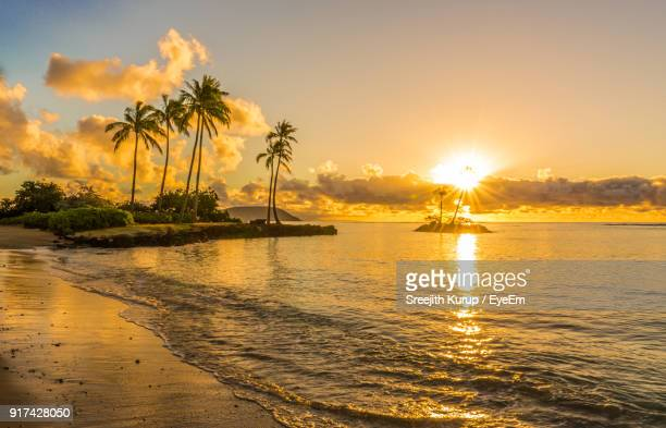 scenic view of sea against sky during sunset - honolulu stock pictures, royalty-free photos & images