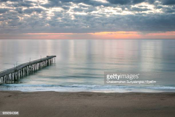 scenic view of sea against sky during sunset - virginia beach stock photos and pictures