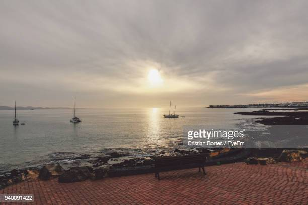 scenic view of sea against sky during sunset - arrecife stock photos and pictures