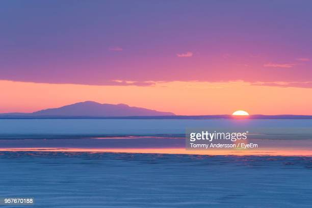 scenic view of sea against sky during sunset - colorful sunset stock photos and pictures