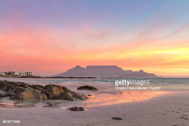 scenic view of sea against sky during sunset - table mountain stock pictures, royalty-free photos & images