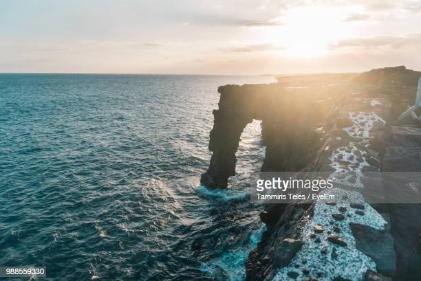scenic view of sea against sky during sunset - hawaii volcanoes national park stock pictures, royalty-free photos & images