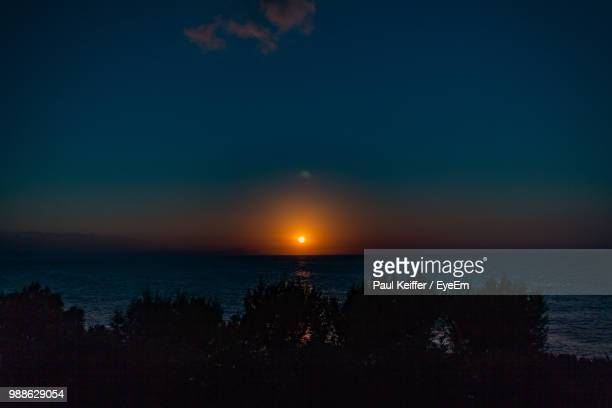 scenic view of sea against sky during sunset - keiffer ストックフォトと画像