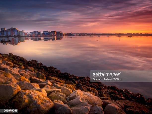 scenic view of sea against sky during sunset, poole, united kingdom - dorset england stock pictures, royalty-free photos & images