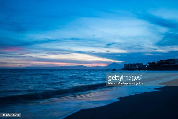 scenic view of sea against sky during sunset taken in isshiki beach, hayama. - 神奈川県 ストックフォトと画像