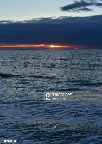 scenic view of sea against sky during sunset, totland bay, united kingdom - totland bay stock pictures, royalty-free photos & images