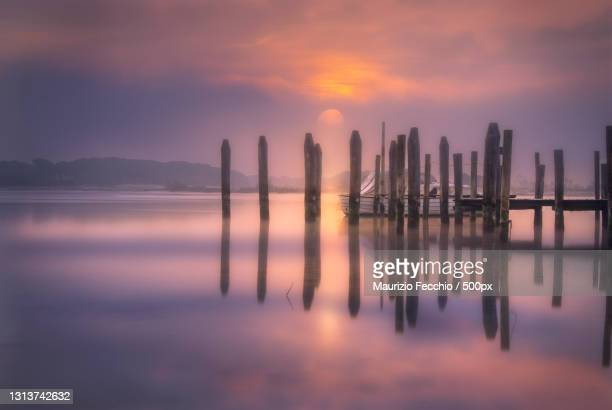scenic view of sea against sky during sunset,caorle,venice,italy - maurizio fecchio foto e immagini stock