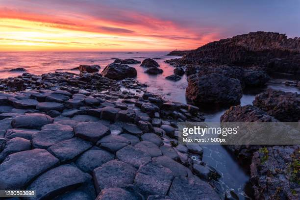 scenic view of sea against sky during sunset,causeway coast and glens,united kingdom,uk - long exposure stock pictures, royalty-free photos & images