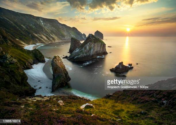 scenic view of sea against sky during sunset,county donegal,ireland - scenics stock pictures, royalty-free photos & images