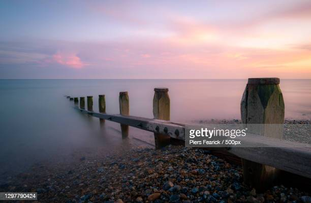 scenic view of sea against sky during sunset,east preston,united kingdom,uk - lancashire stock pictures, royalty-free photos & images