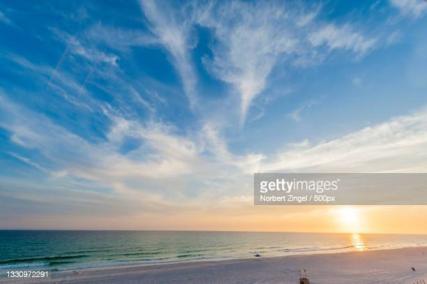 scenic view of sea against sky during sunset,florida,united states,usa - norbert zingel stock-fotos und bilder