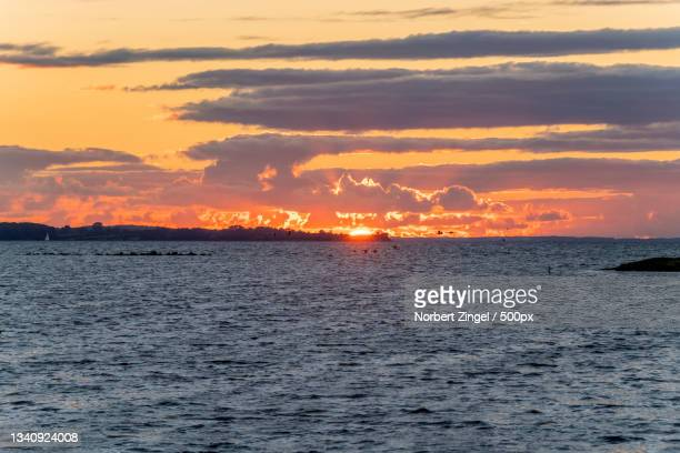 scenic view of sea against sky during sunset,gelting,germany - norbert zingel stock-fotos und bilder