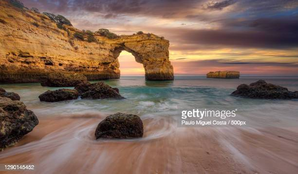 scenic view of sea against sky during sunset,praia da marinha,portugal - portugal stock pictures, royalty-free photos & images