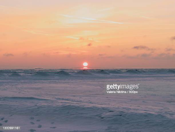 scenic view of sea against sky during sunset,russia - nikitina stock pictures, royalty-free photos & images
