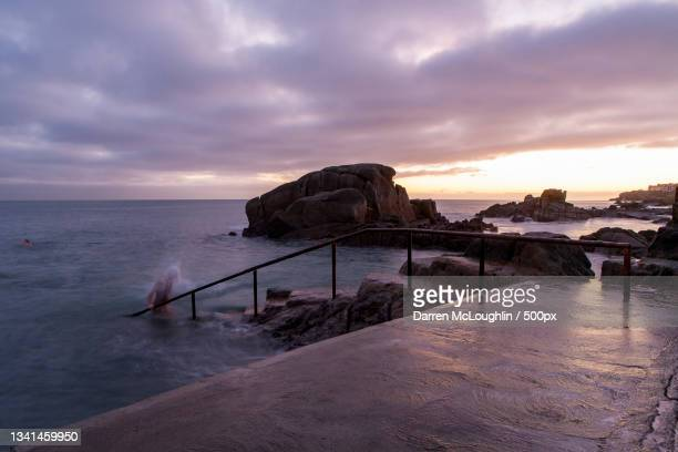 scenic view of sea against sky during sunset,sandycove,dublin,ireland - leinster province stock pictures, royalty-free photos & images