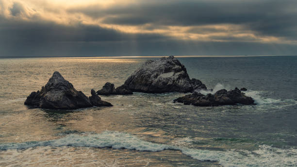 Scenic view of sea against sky during sunset,Seal Rocks,United States,USA
