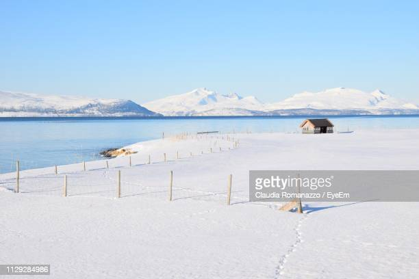 scenic view of sea against sky during winter - claudia romanazzo foto e immagini stock