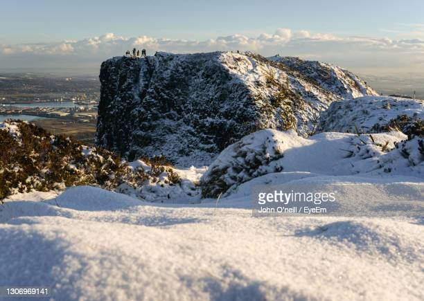 scenic view of sea against sky during winter - belfast stock pictures, royalty-free photos & images